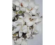 Para crear un ambiente festivo, prístino blanco Magnolia y Snowberry corona de Navidad