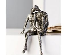 """Escultura """"Couple"""", sentados en el canto"""
